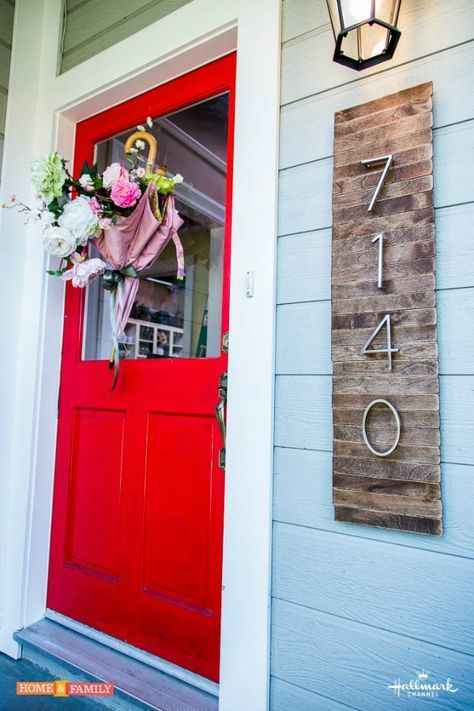 Use basic plywood boards as a backdrop for a rustic number display.