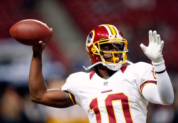 Quarterback Robert Griffin III #10 of the Washington Redskins warms up prior to the start of the game against the St. Louis Rams at Edward J...