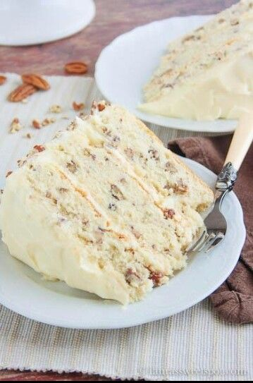 BUTTER PECAN CAKE 2 & 2/3 cups chopped pecans 1-1/4 cups butter, softened divided 2 cups sugar 4 eggs 2 tsp vanilla extract 3 cups all-purpose flour 2 tsp baking powder 1/2 tsp salt 1 cup milk FROSTING: 1 cup butter, softened 8 to 8-1/2 cups confectioners' sugar 1 can (5 ounces) evaporated milk 2 tsps vanilla extract