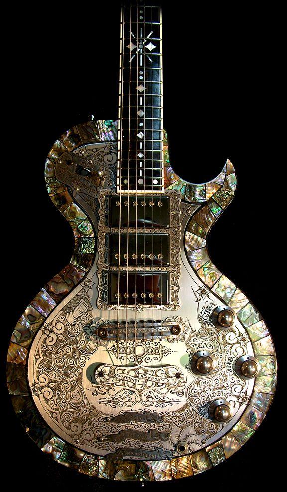 What a unique guitar! abalone love #guitarstuff