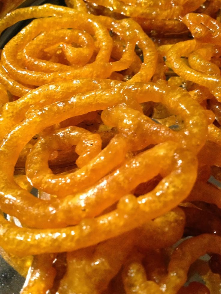 Jilebi - indian funnel cake.  Thin crispy layers soaked in syrup.  Great Dessert Recipe.  Easy to follow. Tastes Great!!