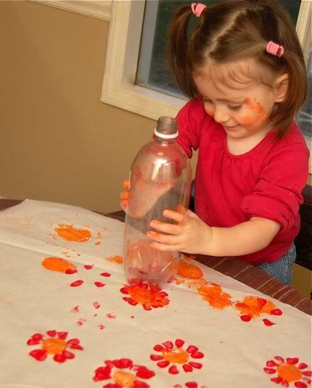 preschool - flowers with empty soda bottle, rotate for more petals, use cap to make the center