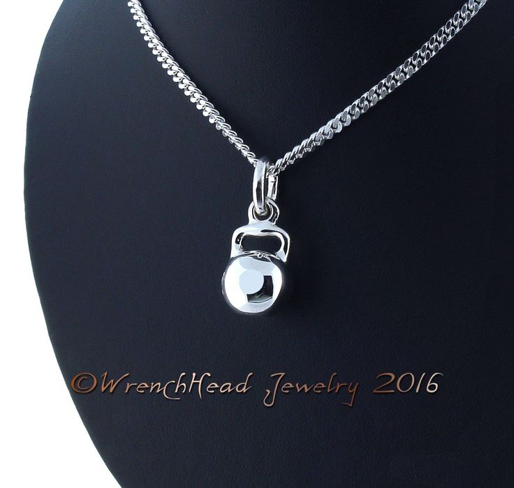 """The Kettle Bell is well known to Fitness Trainers and Body Builders everywhere. This Pendant measures 1/2"""" in diameter and 1 1/8"""" long including the chain loop.It is cast in Designer Sterling Silver which is one of the finest Alloys available. This exceptional metal exhibits a fine white color and has anti tarnish qualities.Also available in 14KT, 18KT and Platinum.Price includes a 22"""" Sterling Silver Italian made medium Curb link with an upgraded Lobster Clas..."""