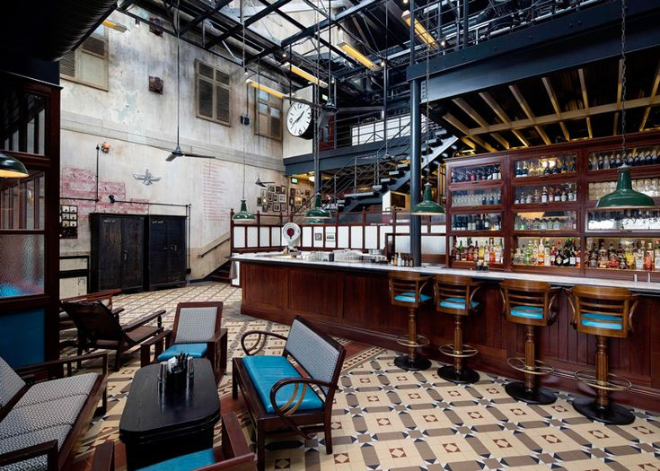 Dishoom restaurant brings Bombay dining to a railway warehouse in London's King's Cross.