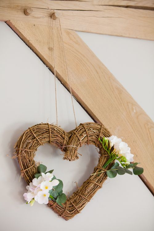 Wicker heart dressed with freesias and eucalyptus