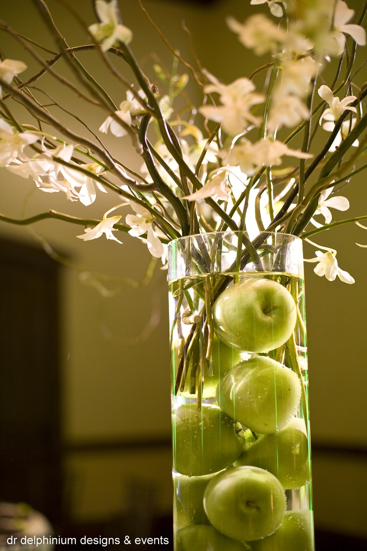 Dr Delphinium Centerpiece. White Orchids and Green Apples