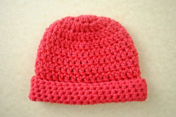 Newborn Crochet Hat - This super simple Newborn Crochet Hat will fit most premies and newborns. It is created using basic double crochet and single crochet and works up quickly using just one skein of Lion Brand's Modern Baby yarn in red.