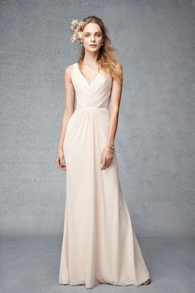 Blush v-neck chiffon bridesmaids' gown by Monique Lhuillier with soft pleating and lace back. Please schedule your appointment at J.J. Kelly Bridal to see it today! www.idoappointments.com