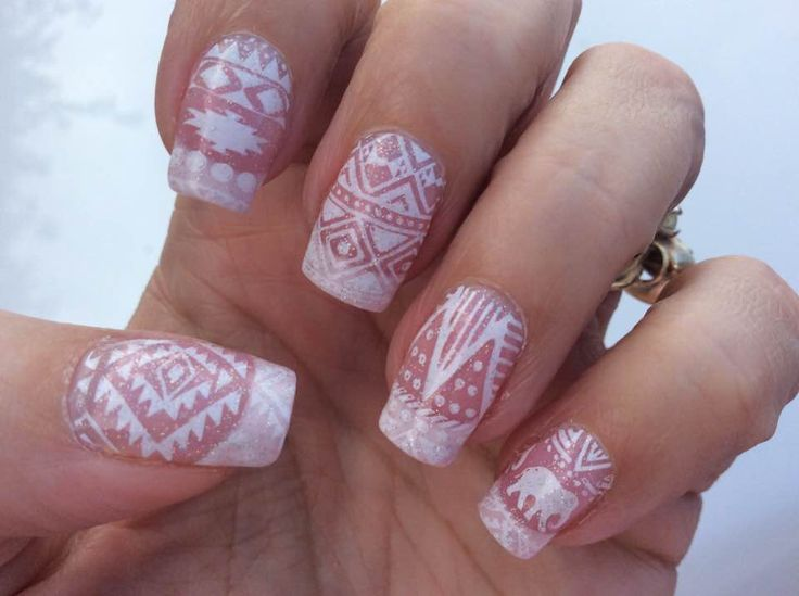 I'm in love with tribal nail art! I used Bundle Monster nail stamping plate BM XL-202, MoYou London stamping polish White Knight and top coated with Out the Door Northern Lights.