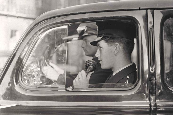 Policeman receiving details of a 999 emergency call. 1955.