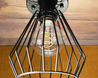 https://www.etsy.com/ca/listing/507616323/tube-black-cage-ceiling-light-industrial?ref=shop_home_active_1