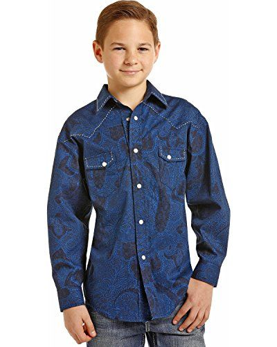 Rock and Roll Cowboy infuses traditional western apparel with rock and roll attitude for the modern cowboy of any age. This stylish western shirt is made from 100% cotton and features a paisley print with striking saddle stitching on the front yokes, collar and flap pockets. Traditional western...