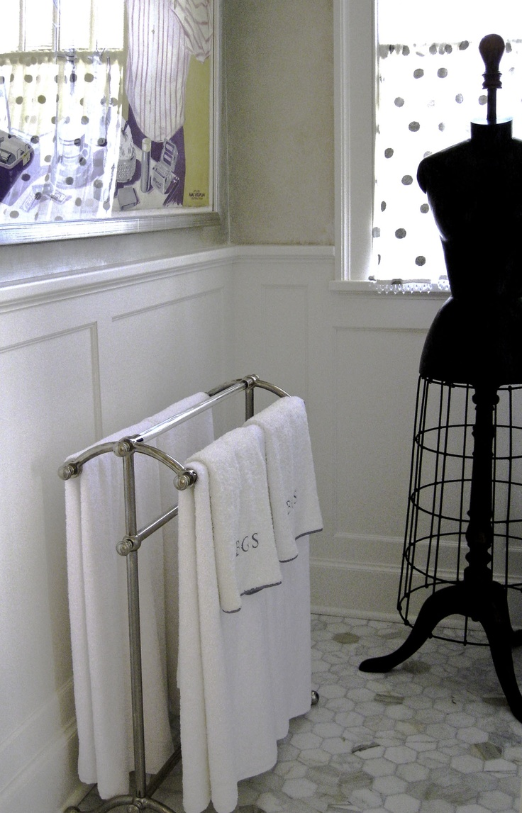 Beautiful Standing Towel Rack With Cast Glass Rods Sits In A Bathroom With Polka Dot  Curtains And An Antique Dress Form.
