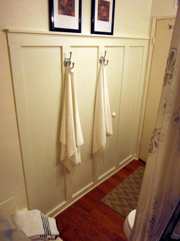 70 s bath gets budget redo faux wainscoting and batten for Inexpensive bathroom updates