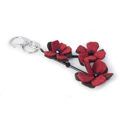 PORTACHIAVI GINEVRA ROSSO MARRONE  -  Portachiavi con pendenti in lana cotta a forma fi fiore. Lungh: 14 cm.