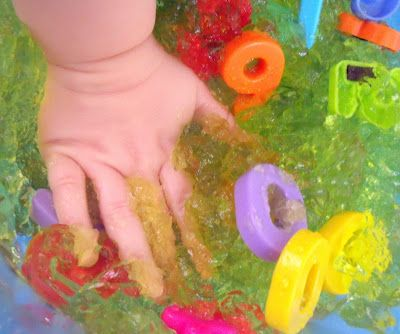 Play with jelly - cold, slimey, squishy, cheap and colourful fun. Bury plastic toys in it before it sets like we did with this Number Jelly or add sweets like these Jelly Snakes to create an all round sensory experience. Have your older kid help you make the jelly and discuss the different properties of the mixture at different stages of the process.