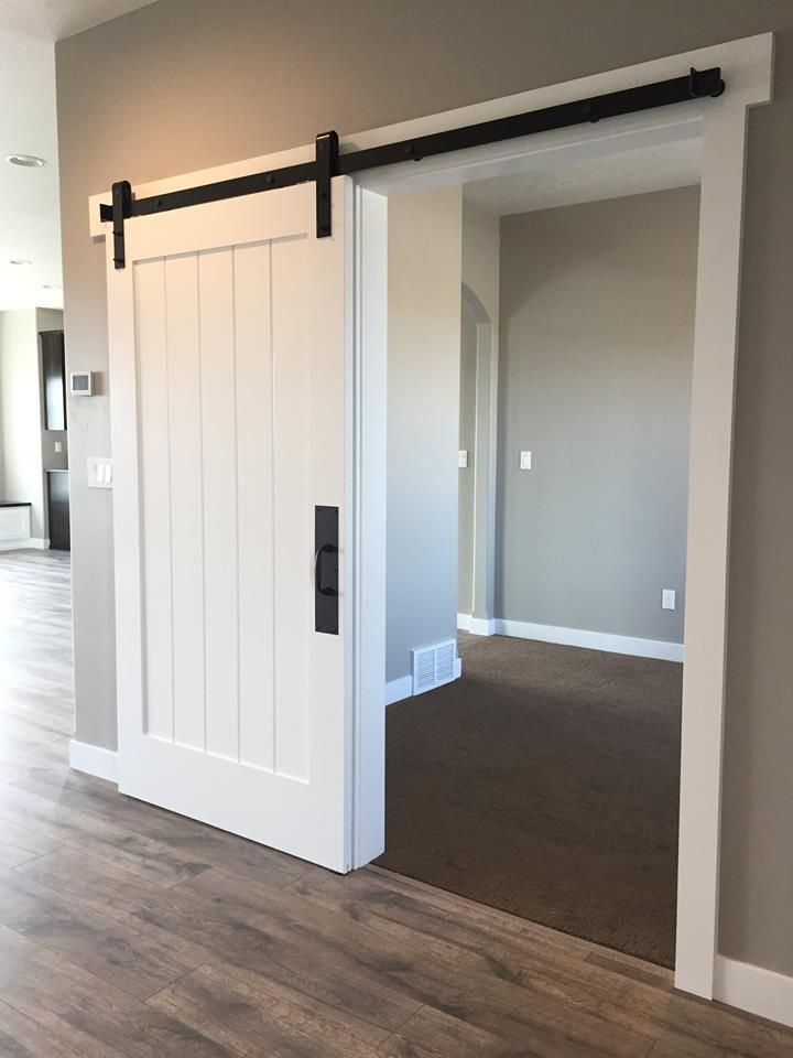 White barn door for the entry closet http www for Barn door closet door ideas