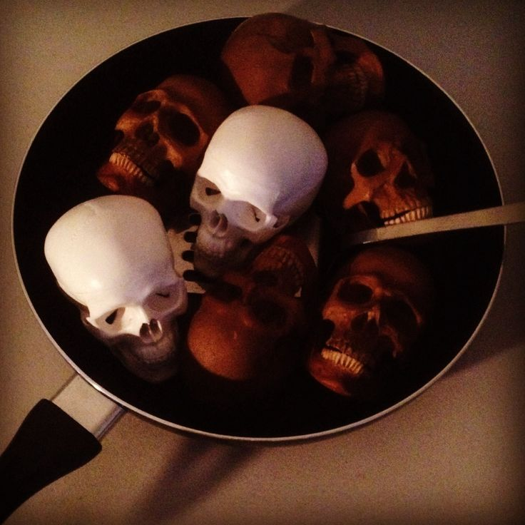 """""""Stir-fry #2"""" by SKOLLTOR. A street art installation in two parts. Recipe - mixed skulls as required, add a dash of tobacco and ample soy sauce. Stir until all ingredients reach the same colour and simmer. Serve and enjoy."""