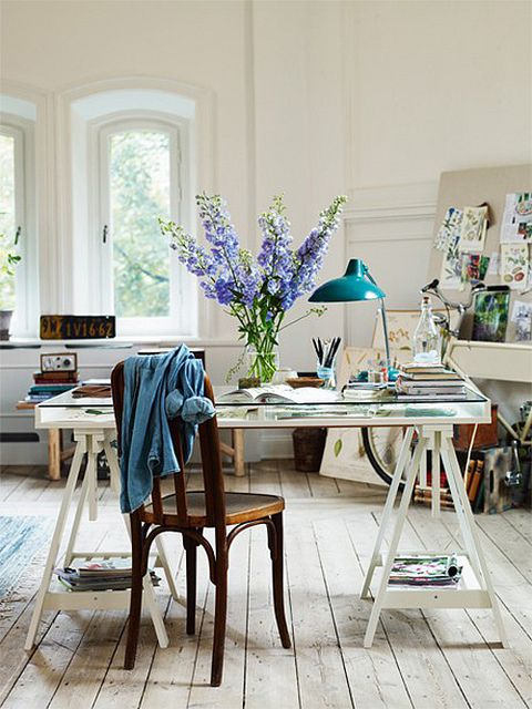 Office / craft space - light, large table, lamp, pin board, touches of colour, flowers