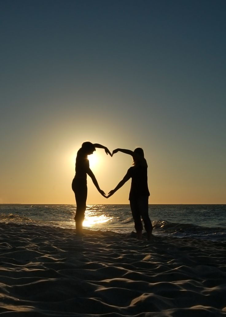 Don't care for the heart but absolutely love the way the sunsets in the picture and the way it makes the couples look