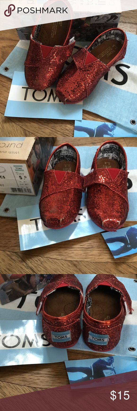 Ruby red glitter baby toddler walker toms sneakers Pre loved tiny toms slip one with Velcro closures.  Just like Dorothy's ruby slippers- would be great for Halloween. Minor wear on tips of toes but otherwise great shape!  Box & pouch included!  Pet free smoke free posher. Toms Shoes Baby & Walker