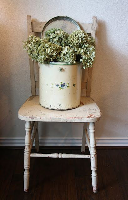 Find an old crock and have dried hydrangeas in it, and then a basket underneath with bunches of them for sale :)