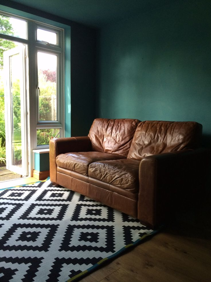 teal and green living room 1000 ideas about teal leather sofas on 21584