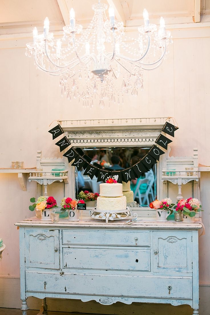Reception Cake Table Vintage Dresser Large Chandelier Handwritten Bunting Wedding Cake Bright Multicoloured Florals Flower Farm Outdoor Wedding Minnesota http://eileenkphoto.com/