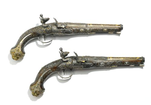 A fine pair of Ottoman silver-inlaid pistols with leather holster, period of Sultan Mahmud II (r.1808-39), Turkey, early 19th century