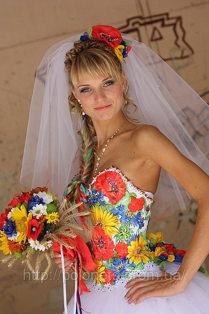 Dress in Ukrainian style. Braid with multicolor ribbons.