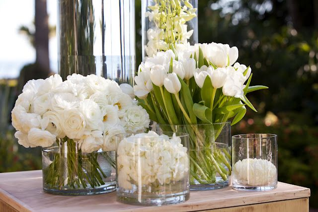 Ranunculus, tulips, and orchids add interesting textures to an all white wedding…