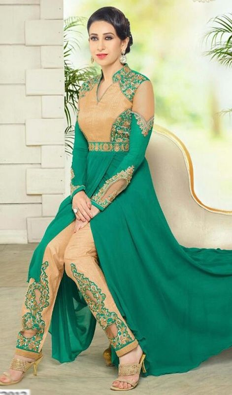 Look as graceful and stylish as Karisma Kapoor dressed in this green color georgette pant style suit. You'll see some fascinating patterns accomplished with lace and resham work. #pantstyleanarkali #designerdresses #bollywoodreplicasuits
