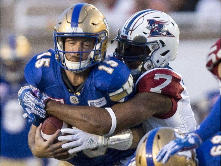 Montreal Alouettes defensive end John Bowman hits Winnipeg Blue Bombers QB - 2017