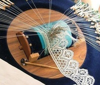 Tombolo - Italian word for cushion used to make bobbin lace (pizzo a tombolo).