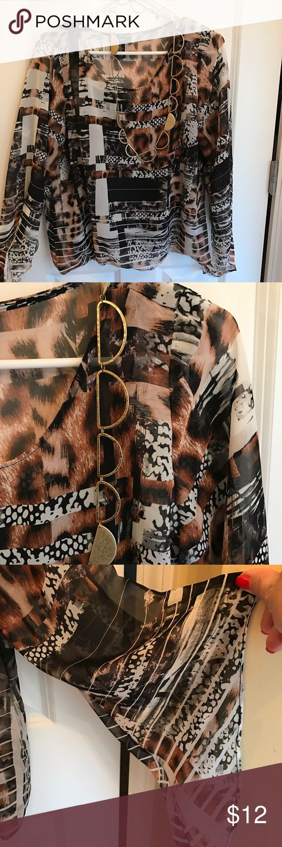 """Animal print sheer blouse with cami 🕶 Beautiful sheer animal print fabric cascades over a black sown in cami☀️. Stylish, cool, very on trend !  Blouse measures approx 20"""" with bell sleeves to drape your arm. Very pretty! Alfani Tops Blouses"""