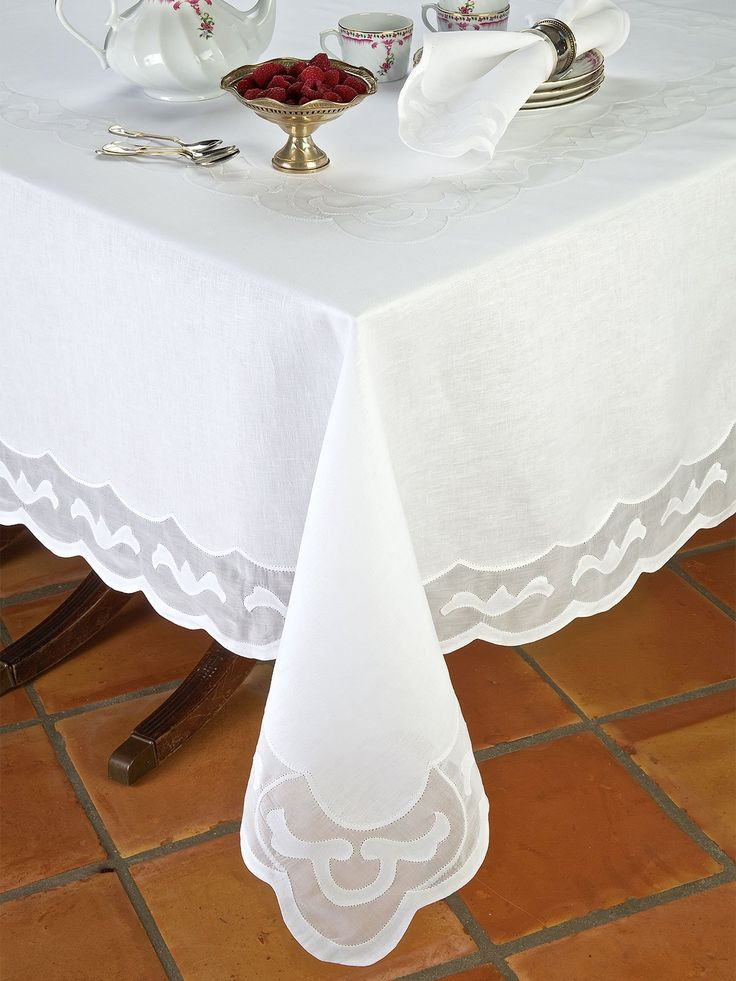 As inspired as a delicious confection, fine Italian linen concocts a treat for the eyes with hand-crafted applique.