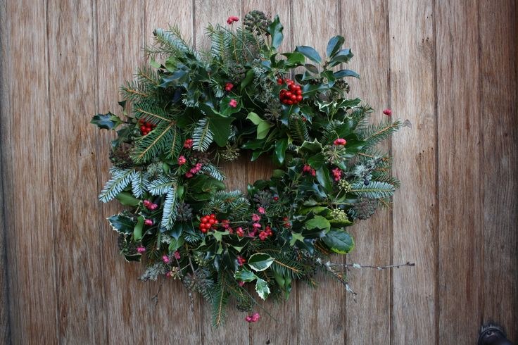 Homemade Christmas wreath for the Front Door. Holly with red berries, Ivy, Black Berried Ivy, Mistle Toe, Pine/christmas tree cut offs, Bay leaf, Elaeagnus, Yew.