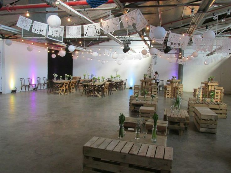 Spring wedding set up - pallet furniture, pontoon lighting and Mexican bunting