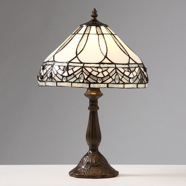 Dress up your favorite table with this white Tiffany table lamp. This lamp is made with beautiful stained glass wrapped in copper foil, so it has an antiqued elegance that you're sure to enjoy showing off when people come to visit your home.