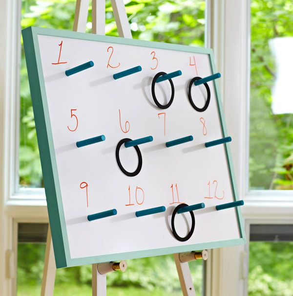 How to build a game board w/ pegs for ring toss & use the other side as a dry erase board.  Idea from Lowe's Home Improvement store.