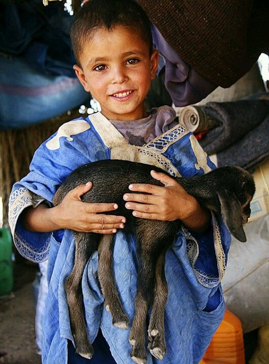 Young Moroccan boy with a goat. So sweet! Though it reminded me of Eid aladha lol.