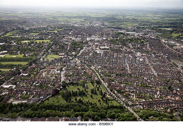 Aerial view west of St Peter s Cemetery Clifton Rd Lower Hillmorton Rd suburban houses sports fields Rugby Town Centre Warwicksh - Stock Image