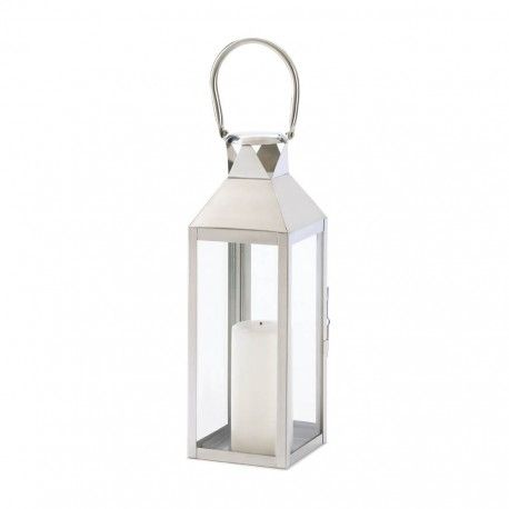 Sleek, simplified shaping and polished silvertone finish make this contemporary candle lantern into a fabulous focus piece! Place a candle inside to create a glowing work of art.