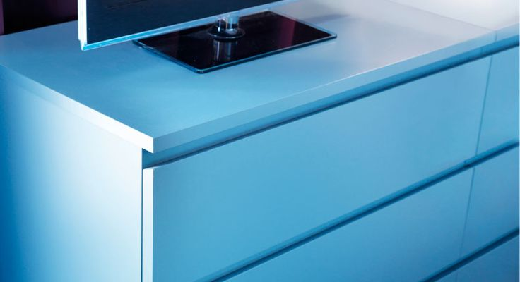 A close-up of MALM chest of 3 drawers in new turquoise colour