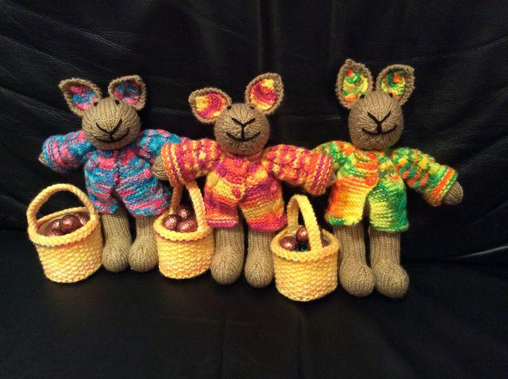 Three little Easter bunnies with jackets and Easter basket filled with mini eggs for three lovely children.