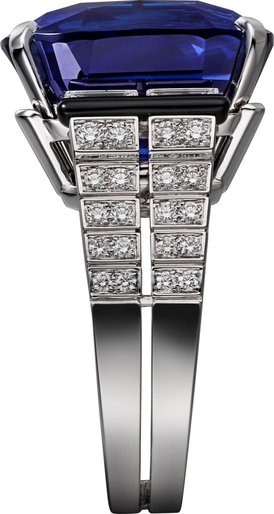 CARTIER. Ring - white gold, one 27.16-carat cushion-shaped sapphire from Ceylon, calibré-cut diamonds, onyx, brilliant-cut diamonds. (=)