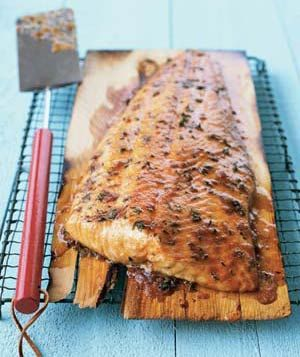 Cedar-Plank Salmon|This easy salmon recipe will impress your holiday barbecue guests. Grilled on a cedar board, the fish picks up lots of smoky, woody aromas and flavors that complement the simple rub of brown sugar, thyme, and cayenne.