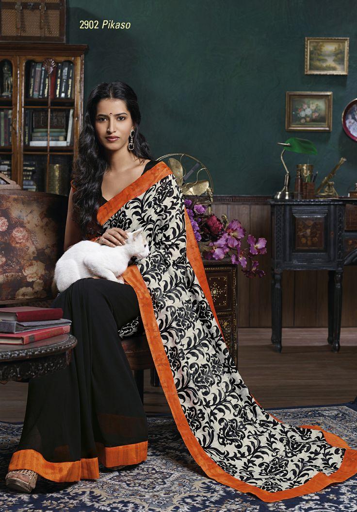 Wonderful black color saree with its elegant printed pallu & orange border patta