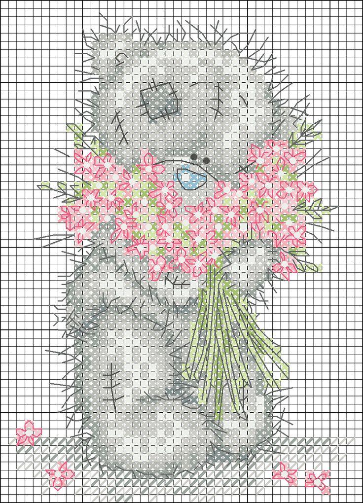 Teddi Orso con un grande mazzo di fiori