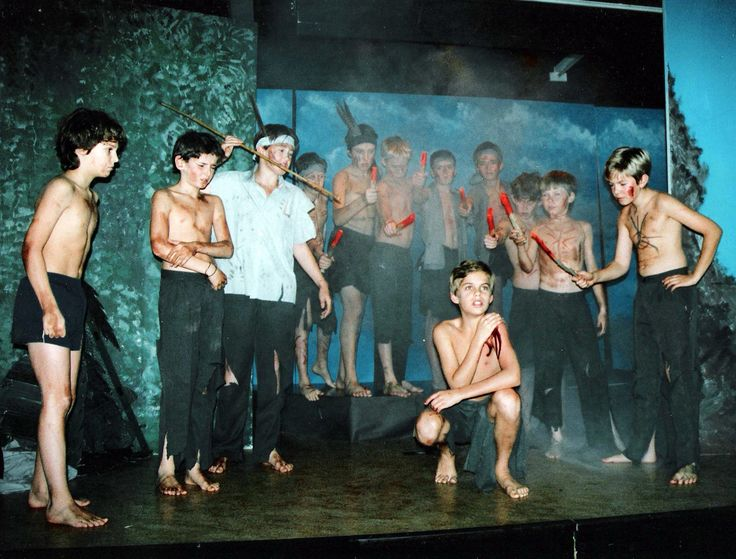 Young Rob in a chool play. He's in the back with the headband on.